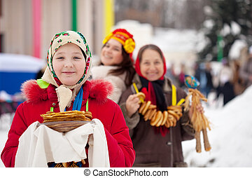 Teenager girl during Shrovetide - Teenager girl with pancake...