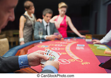 Man has good hand at poker game in casino