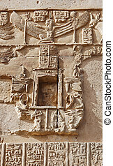 Ancient Egyptian hieroglyphics on wall in Kom Ombo temple,...