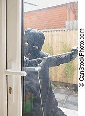 Burglar opening door with crow bar - Buglar opening door...