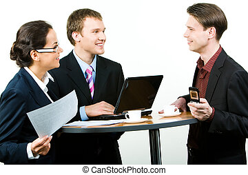 Corporate work - Three successful professionals sitting at...