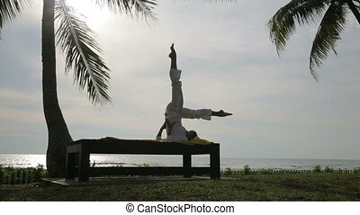 silhouette yoga meditation at beach