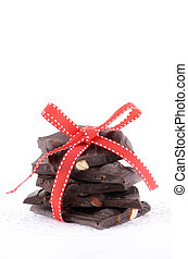 Almond bark - Dark chocolate almond bark in a stack with red...