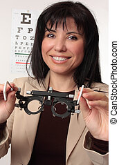 Optometrist holding trial frames - Friendly smiling...