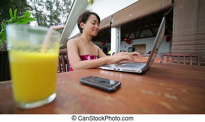 Freelancer woman working at cafe