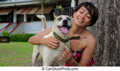 Asian woman exercise her dog