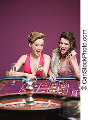 Women winning on roulette table