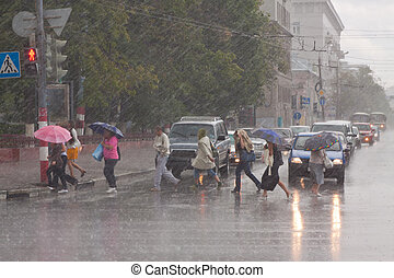 Rain at city streets in July