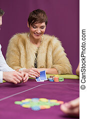 Woman smiling looking at her cards