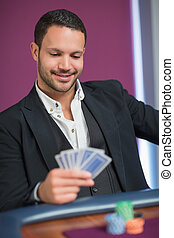 Man holding cards smiling