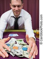 Man winning the jackpot in poker