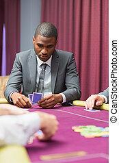 Man looking at his cards