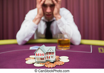 Man is betting his house at poker game in casino