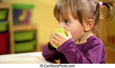 Babies and food, child eating apple