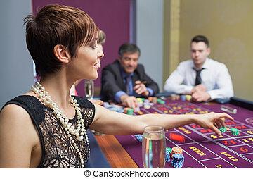 Woman placing a bet