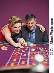 Woman placing bet for man