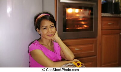 woman waiting for food in kitchen
