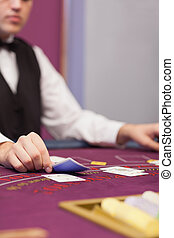 Dealer at table in a casino