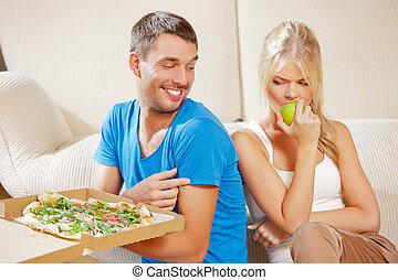 couple eating different food - bright picture of couple...