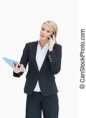 Woman using cell phone and tablet