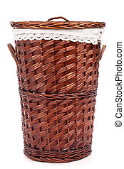 Wicker hamper full of dirty clothes over white background