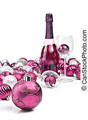 Pink christmas ornaments with sparkling wine