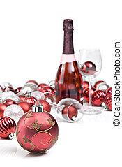 Red christmas ornaments with sparkling wine