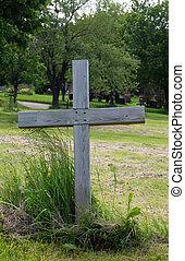 Single wood cross in a cemetery