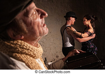 Bandoneon Player with Tango Dancers - Handsome male and...