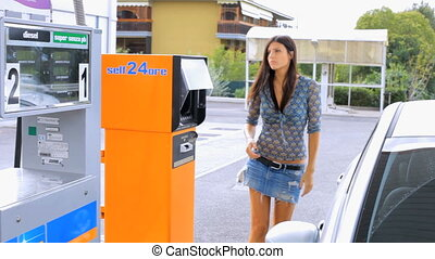 Woman upset about price of gas - Beautiful woman getting...
