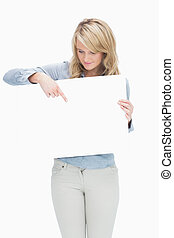 Woman pointing on the piece of paper