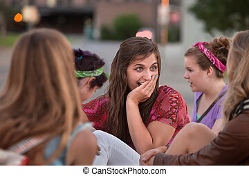 Embarrassed Teen with Hand on Mouth - Embarrassed teenage...