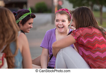 Four Teen Girls Giggling - Mixed group of four teenage girls...