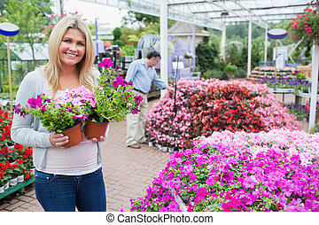 Female customer in garden center - Blonde female customer in...