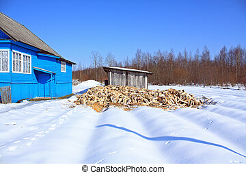 damp firewood near rural building
