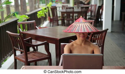 Asian woman at cafe