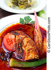 Traditional Malaysia Fish dish - called Asam Pedas. It is...
