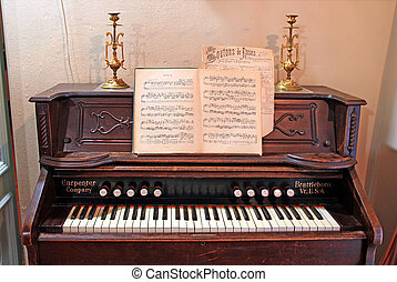old-time harpsichord in dark room