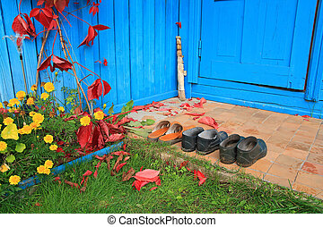 aging footwear on porch of the rural building