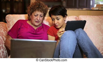 Mother daughter using tablet computer