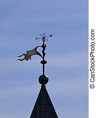 weather vane - Metallic weather vane against the blue sky