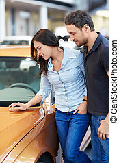 Chooses a car - Attractive couple chooses a car