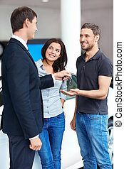 Happy people - Seller and a couple in the showroom