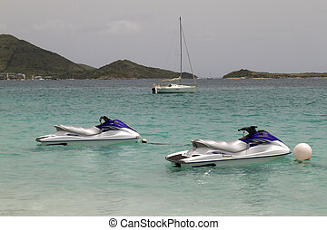 Jet Skies - Two jet skies tied up in the Caribbean Sea