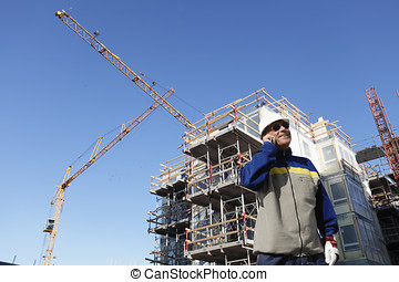 building worker and industry - building worker talking in...