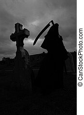 Grim Reaper - Silhoutte of the grim reaper in a graveyard