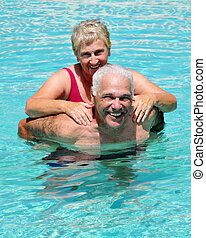 Senior Pool Fun - Seniors in a swimming pool, the wife...