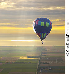Hot air balloon with beautiful sunset sky