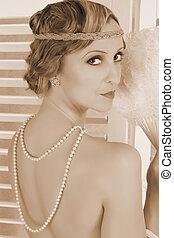 Elegant pearls on nude lady
