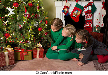 Sisters at the christmas tree - Christmas tree with 3 young...